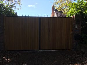 metal gates with timber frontage