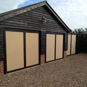 solid framed ledges and braced garage doors with matching gates