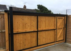 solid sliding gate with wicket door -rear view