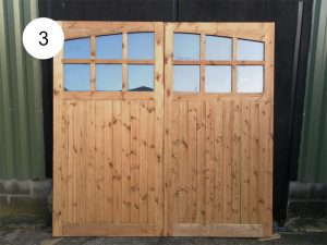 Garage doors with arched glazed section
